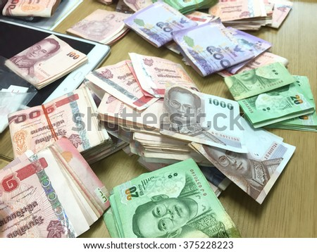 Thai money,banknotes scattered on the table