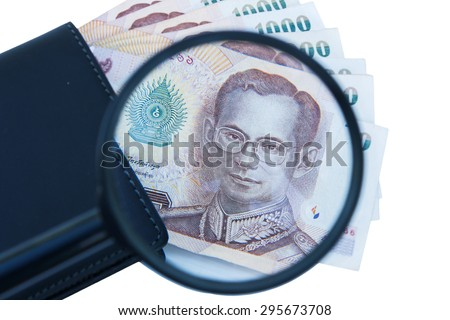 Thai money in black wallet isolate background
