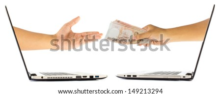 Thai Money in hand grom laptop isolated on white background - stock photo