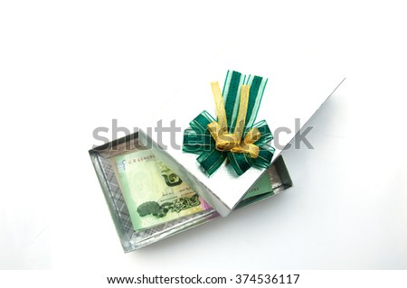 Thai money in silver gift box with green ribbon