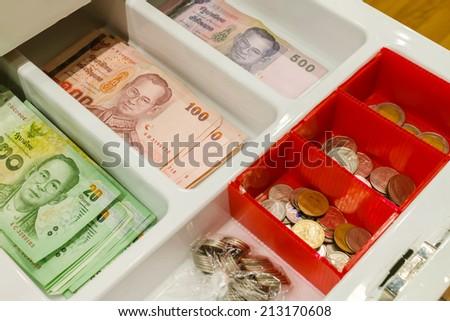 thai money in the cash drawer - stock photo