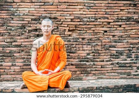 Thai monk meditation at temple in Ayutthaya, Thailand - stock photo