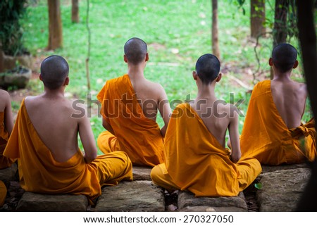 Thai monks in actions  - stock photo