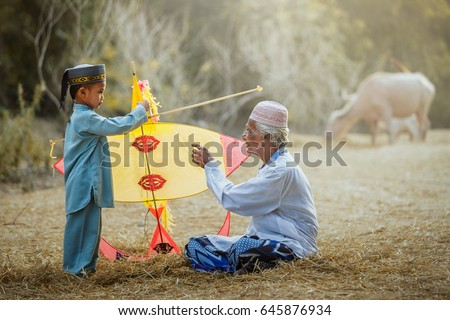 Thai Muslims living in southern of Thailand are playing kites with fun.
