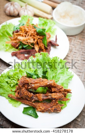 Thai native food, Fried Duck Lips - stock photo