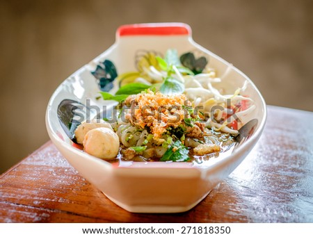 Thai noodle soup (Kuay Tiew Ruer). Serve with Basil, bean Sprouts. This kind of food is very simple food as you can easy looking for every where in Thailand cost just 1-2 us dollars & very delicious. - stock photo