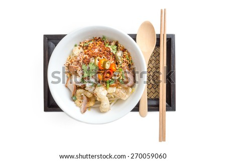 Thai Noodle with meat ball and  crispy pork skin isolated on white - stock photo