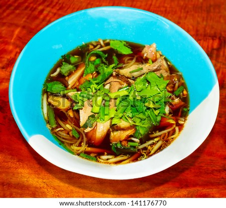 Thai noodles with duck soup in the bowl - stock photo