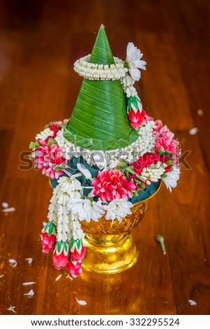 Thai offering dish with banana leaf cone for auspicious ceremony. It is a tray with pedestal in Thai culture. - stock photo