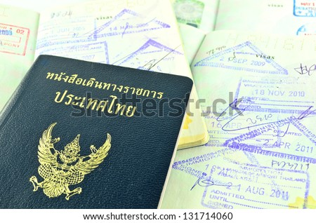Thai official passport and immigration stapms - stock photo