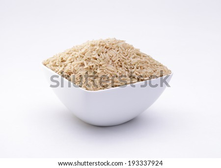 Thai organic brown rice in the bowl isolated on white background  - stock photo