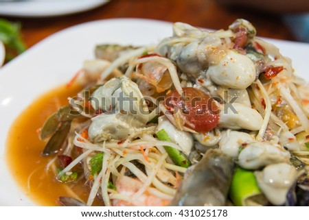 thai oyster papaya salad hot and spicy closeup - stock photo