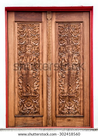 thai painting in wooden door - stock photo