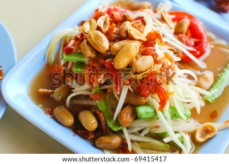 thai papaya salad hot and spicy mixed from variety of vegetable closeup - stock photo