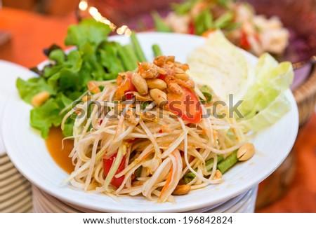 Thai papaya salad serve with vegetables - stock photo
