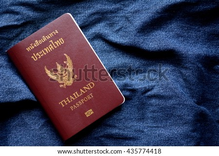 Thai passport on jean background