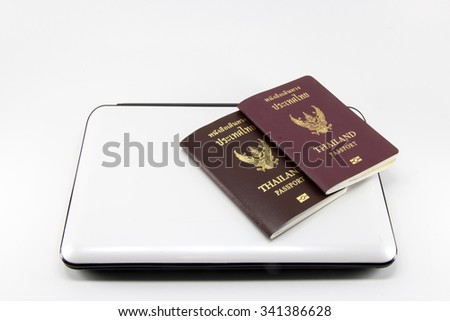 thai passport with computer on white background