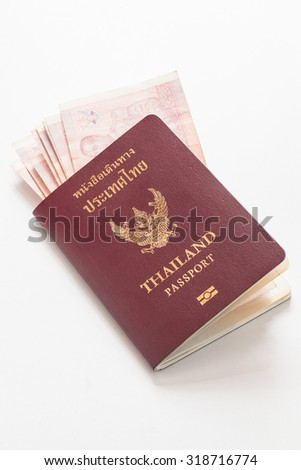 Thai passport with money on white background.