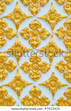 Thai pattern with golden flower - stock photo