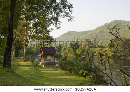 Thai pavilion at the riverside. - stock photo