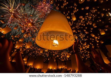 Thai people floating lamp in Yeepeng festival - stock photo