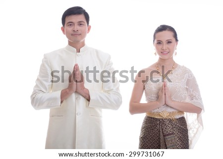 Thai people welcome with traditional Thai suit in Studio