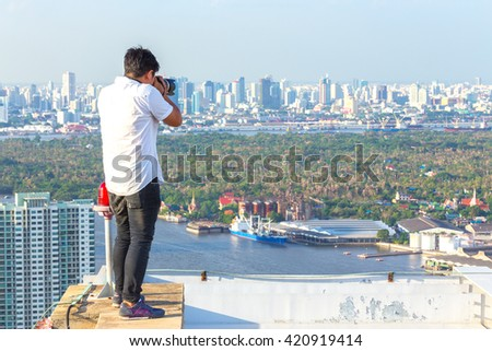 Thai photographer or traveller using a professional DSLR camera for background. - stock photo