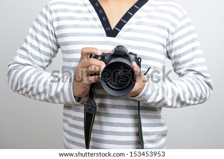 Thai photographer using a professional DSLR camera