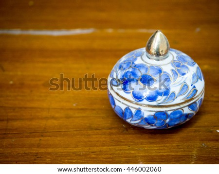 thai porcelain on wood floor