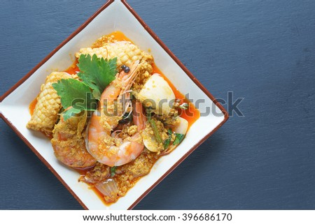 Thai Prawn Curry - King prawns in red curry sauce and coconut milk  - stock photo
