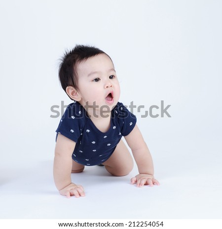 Thai pretty baby crawling isolated
