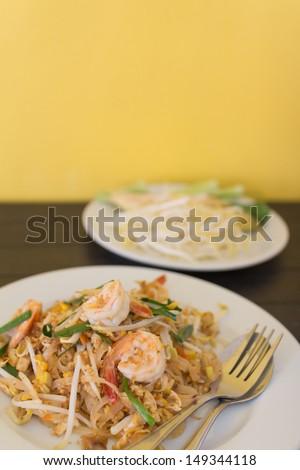 Thai's dish Phad thai. Fried noodle with shrimp. - stock photo