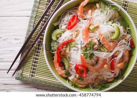 Thai salad with glass noodles, prawns and peanuts in a bowl close-up. horizontal view from above - stock photo