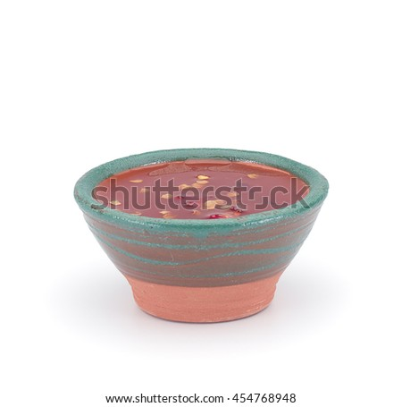 Thai sauce in a clay sauce-boat isolated on white background - stock photo