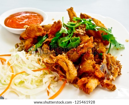 Thai seafood, crispy fried fish meat with chili sauce
