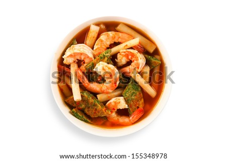 Thai soup, Shrimp And Mixed Vegetable omelet in orange Spicy tamarind and spice Soup (kang som cha-om koong) - stock photo