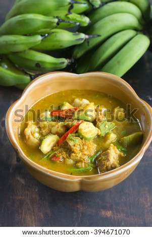 thai southern food, pork cartilage and baby banana spicy herbal curry. - stock photo