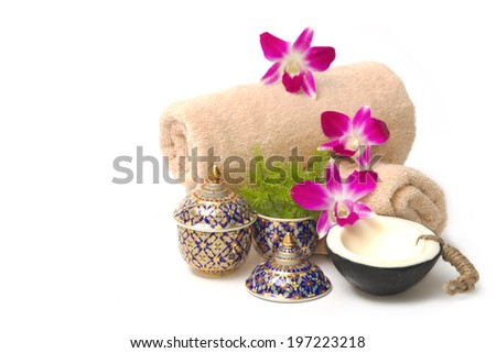 Thai spa massage setting with spa  essential oil , towel, organic soap and orchid - stock photo