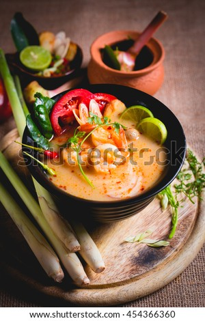 Thai spicy and sour soup with prawn (Tom Yum Goong), popular Thai cuisine - stock photo