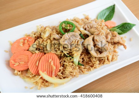 Thai spicy food, fried rice pork with basil - stock photo