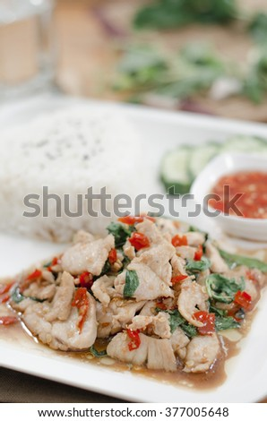 Thai spicy food, stir fried chicken whit basil on rice in Thailand ThaiStyle