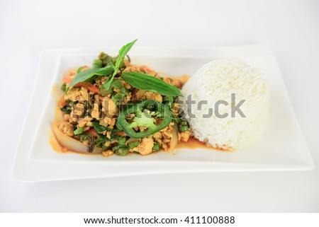 Thai spicy food, stir fried chicken with basil - stock photo