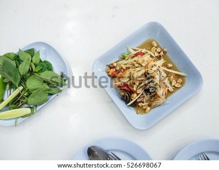 Thai spicy fruit salad on plate with various Thai vegetable