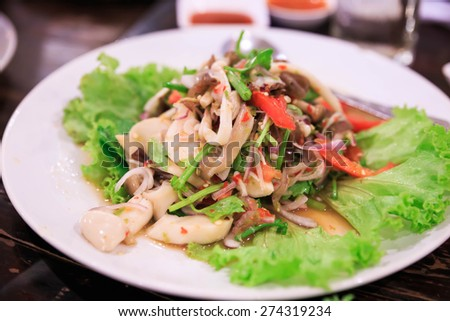 thai spicy mushroom salad on the table. - stock photo