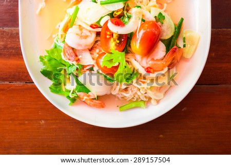 Thai spicy salad with mixed seafood