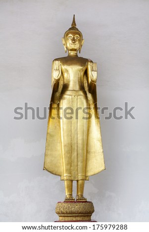 Thai Standing  Golden Buddha in the temple of Thailand - stock photo