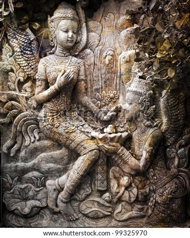 Thai statue art wall - stock photo