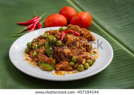 Thai stir fried pork with curry paste - stock photo