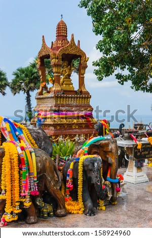 Thai stone elephant on a pedestal on a sunny day in Thailand