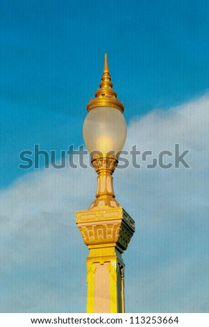 Thai street lamp on blue sky background. On an old paper.